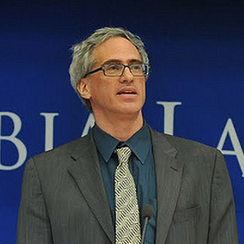 Peter Rosenblum speaking while wearing a suit and tie.